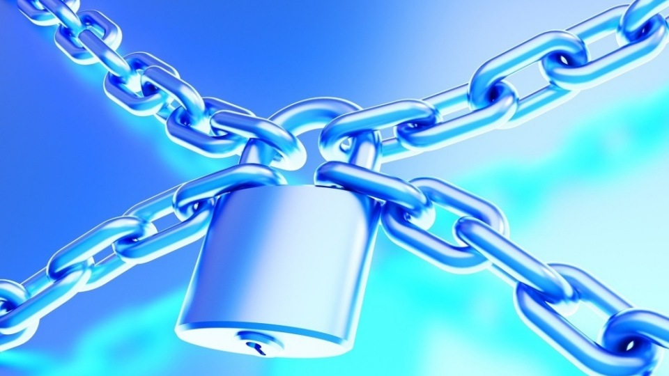 The chain is locked by the padlock. Security concept.