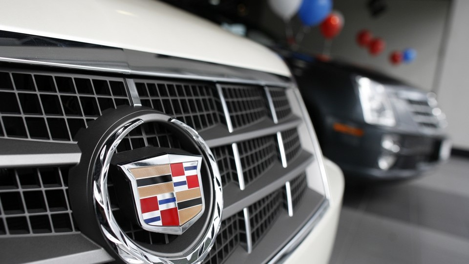 The grill of a Cadillac is seen inside the showroom of the General Motors Corp.'s Harlem Auto Mall in New York